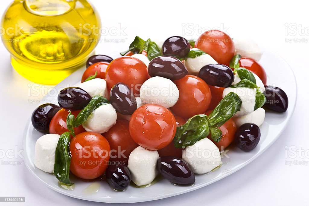 Greek Salad , Olive Oil in Bottle and Mocarela royalty-free stock photo