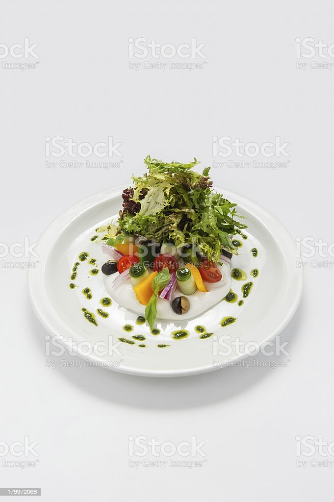 Greek salad on a white plate royalty-free stock photo