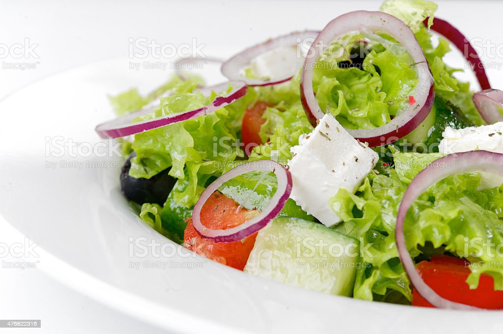 Greek salad on a white plate stock photo