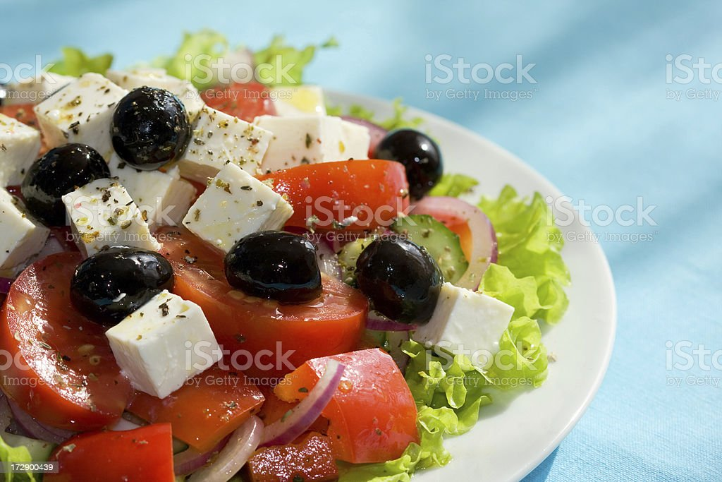 Greek Salad on light blue background royalty-free stock photo