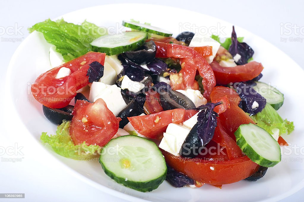 Greek salad on white plate royalty-free stock photo