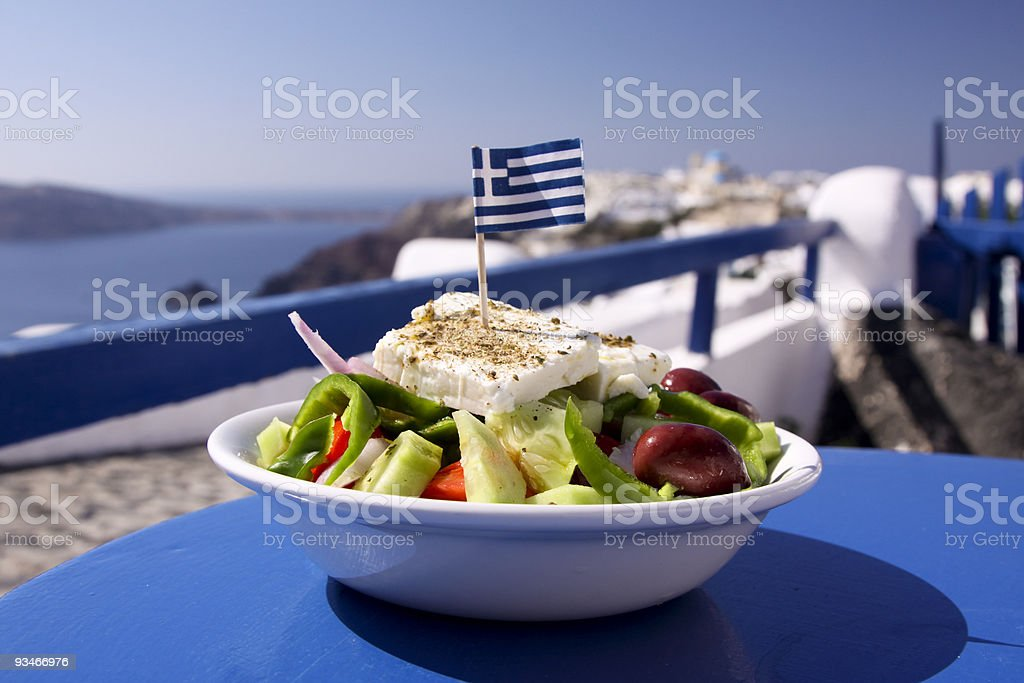 Greek salad served by the water in Santorini, Greece stock photo