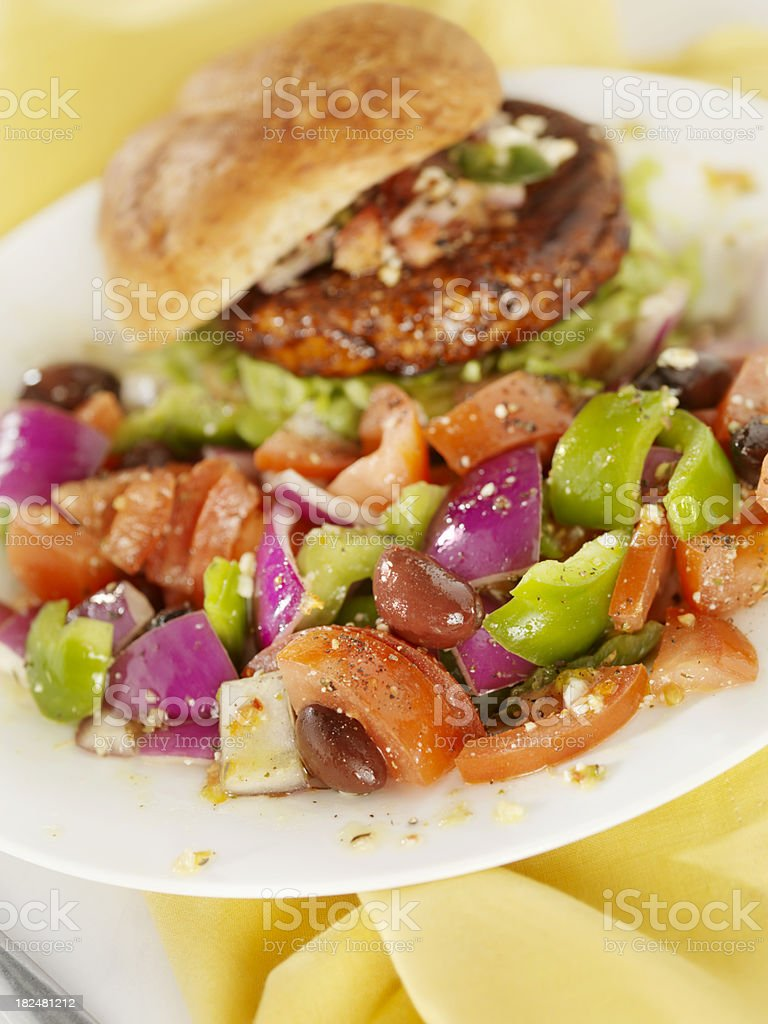 Greek Salad with a Teriyaki Chicken Burger royalty-free stock photo