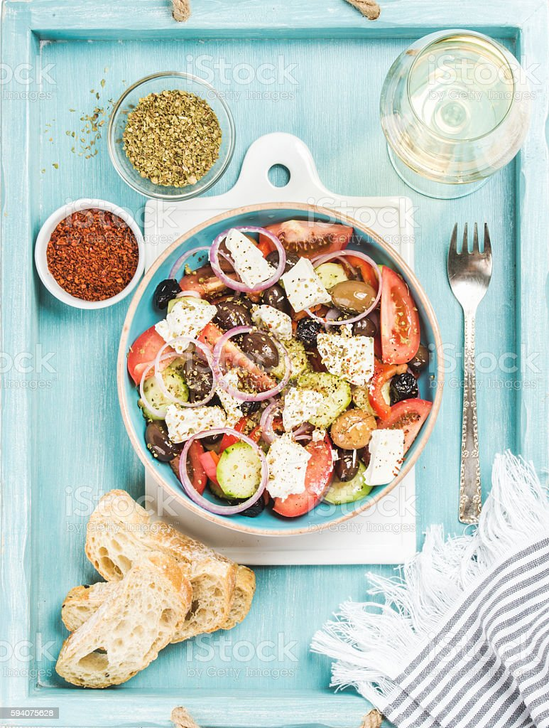 Greek salad with bread, oregano, pepper and glass of wine stock photo