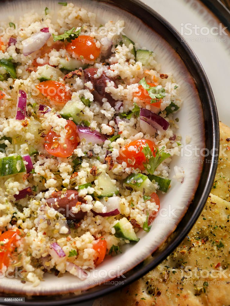 Greek Salad with Couscous and Flat Bread stock photo