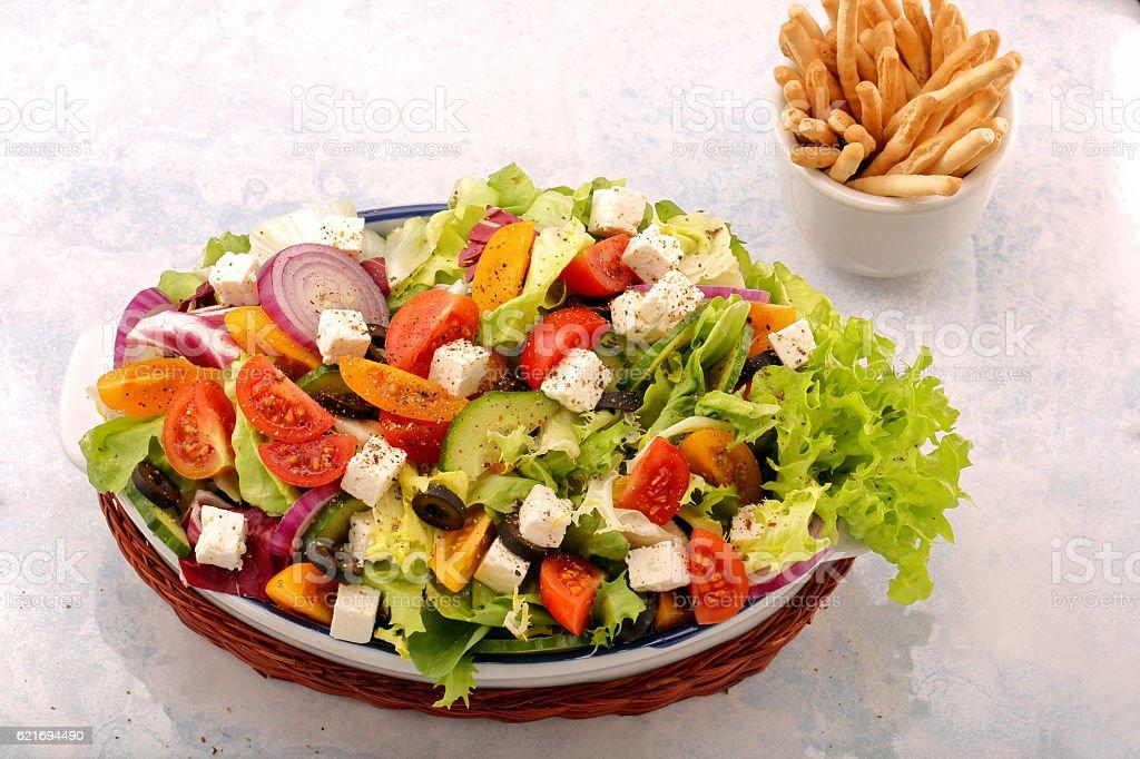 Greek salad with feta cheese black olives and crostini sticks stock photo