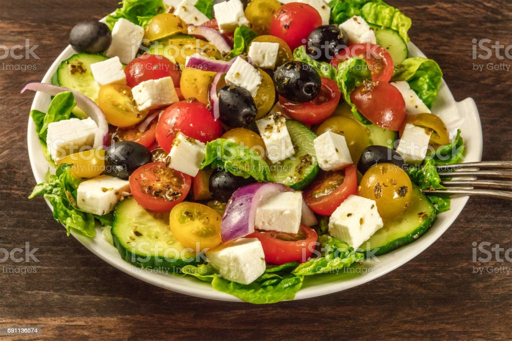 Greek salad with feta, fresh vegetables, and copyspace stock photo
