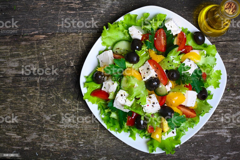 Greek salad with fresh vegetables, feta cheese and black olives stock photo