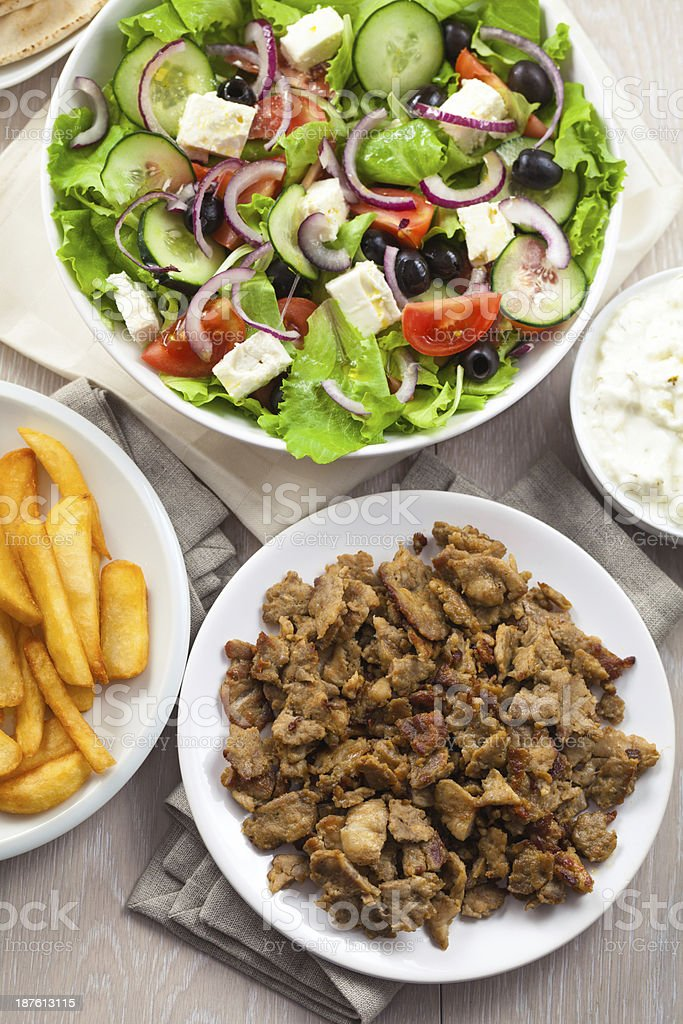 Greek Salad with Gyros and Fries stock photo