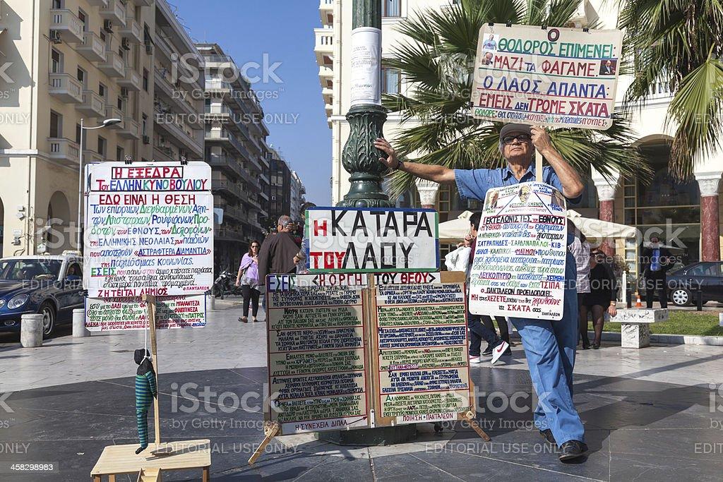 Greek senior protesting in Thessaloniki, Greece royalty-free stock photo