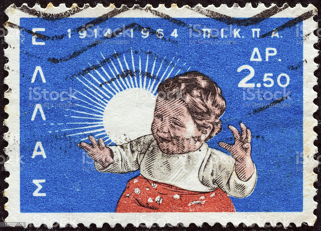 Greek stamp shows a child (1964) royalty-free stock photo