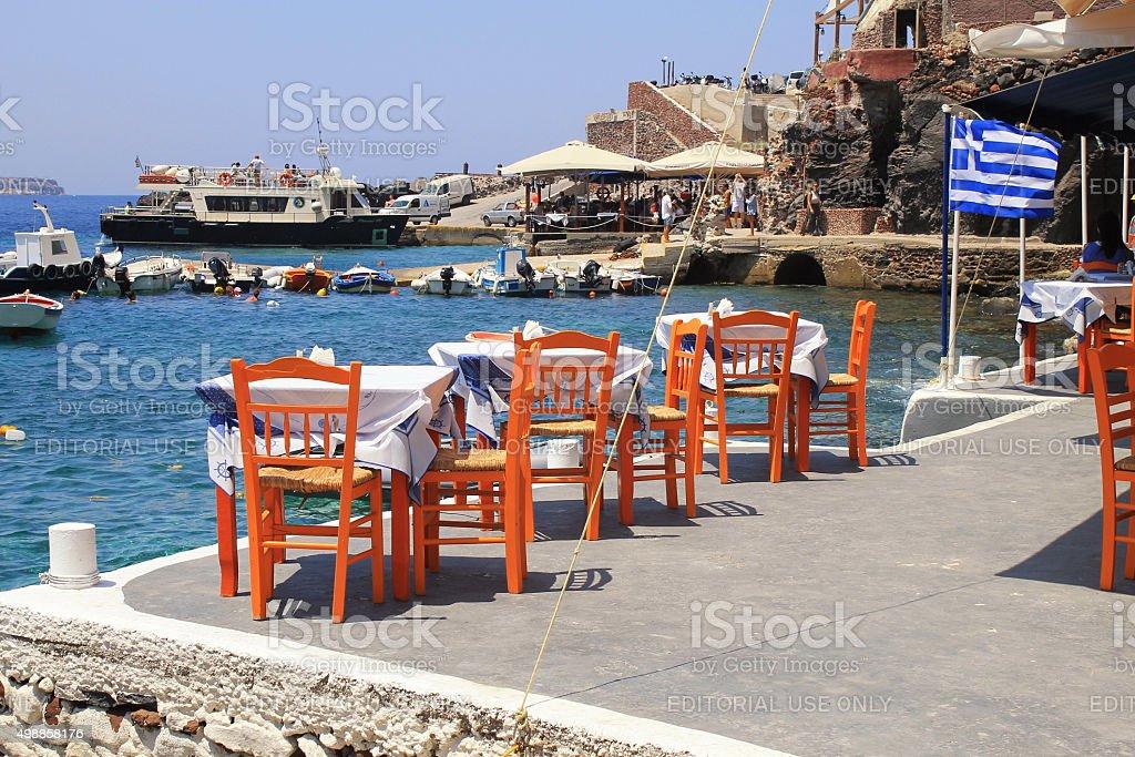 Greek tavern with orange wooden chairs, Santorini , Greece stock photo