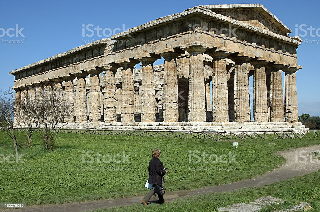 Greek temple and person stock photo
