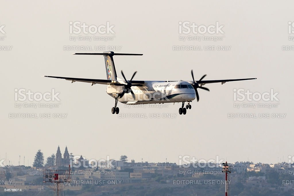Greek Turboprop airliner landing stock photo