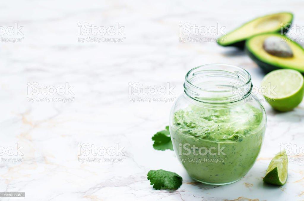 Greek yogurt avocado cilantro lime dressing stock photo