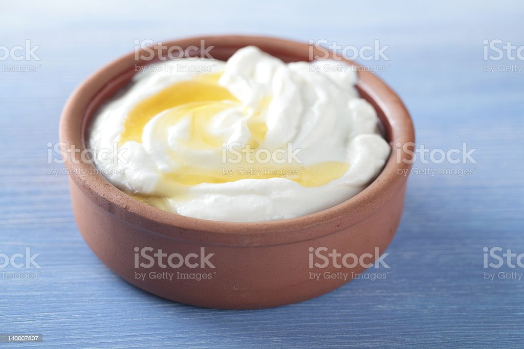 Greek yogurt with honey stock photo