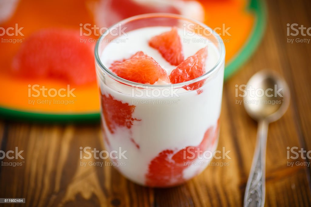 Greek yogurt with red grapefruit stock photo