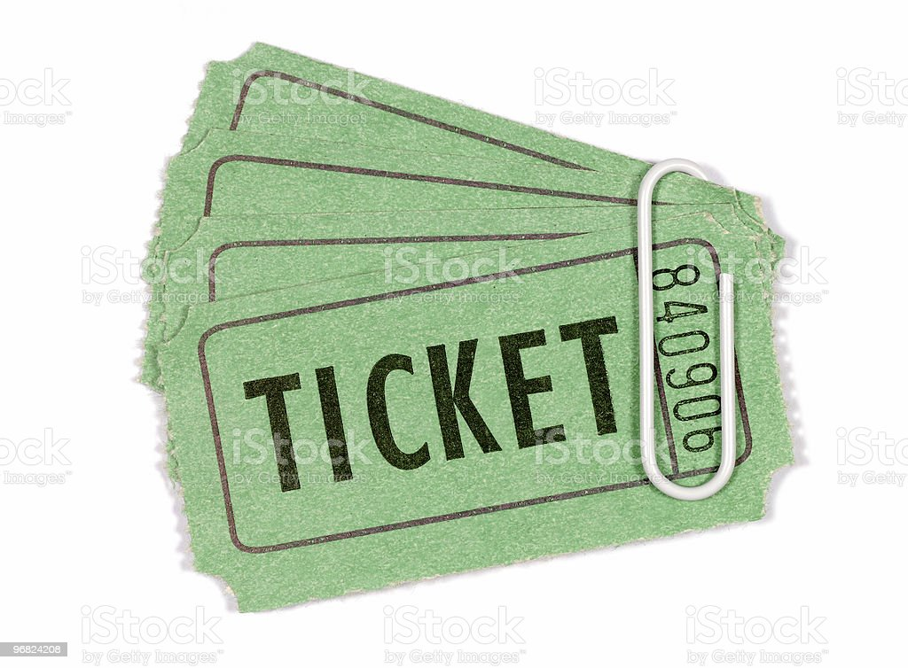 Green admission or raffle tickets with paperclip royalty-free stock photo