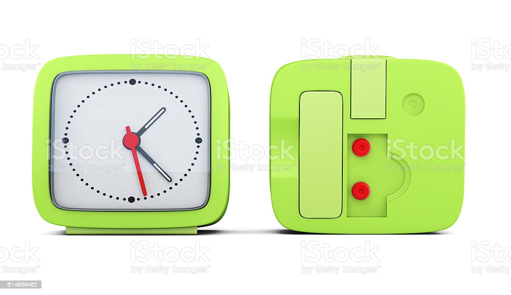 Green alarm clock with the two sides stock photo