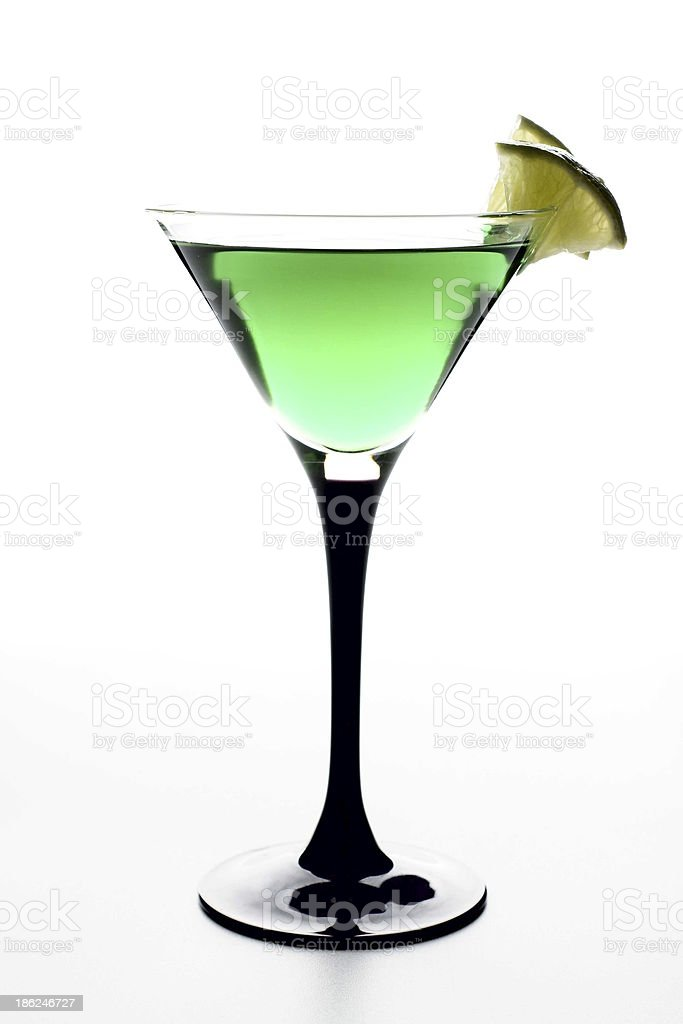 Green alcohol cocktail with lime royalty-free stock photo