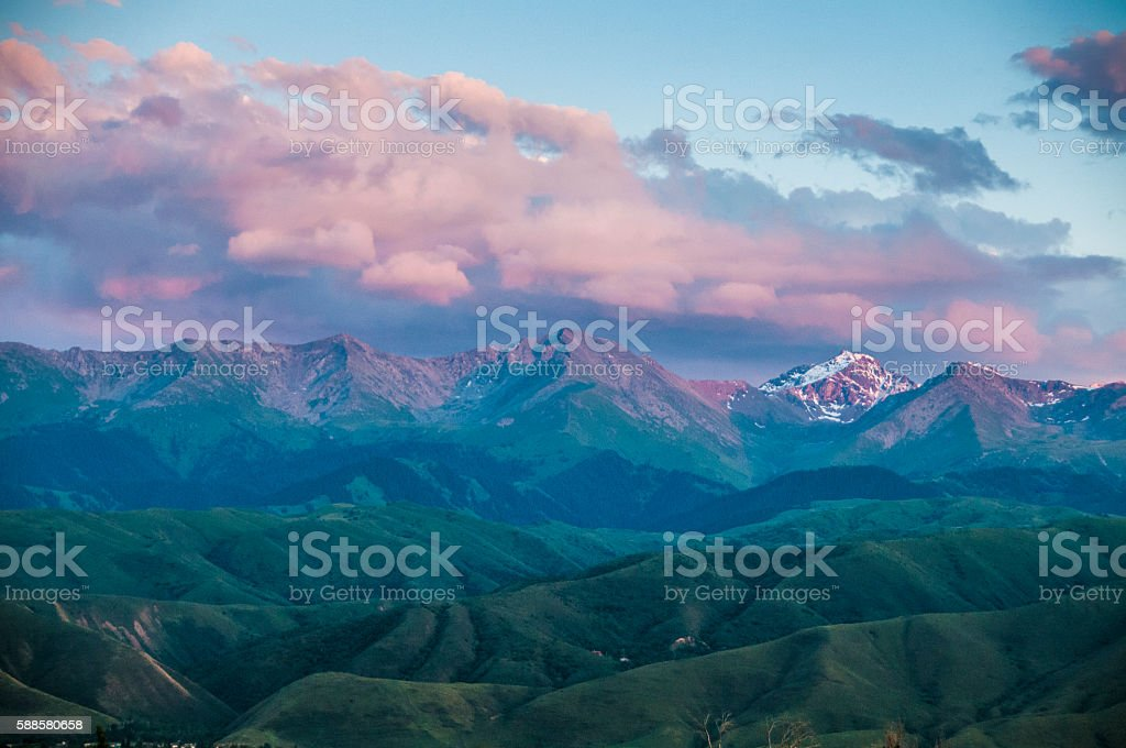 Green alpine meadows of Tian Shan at sunset stock photo
