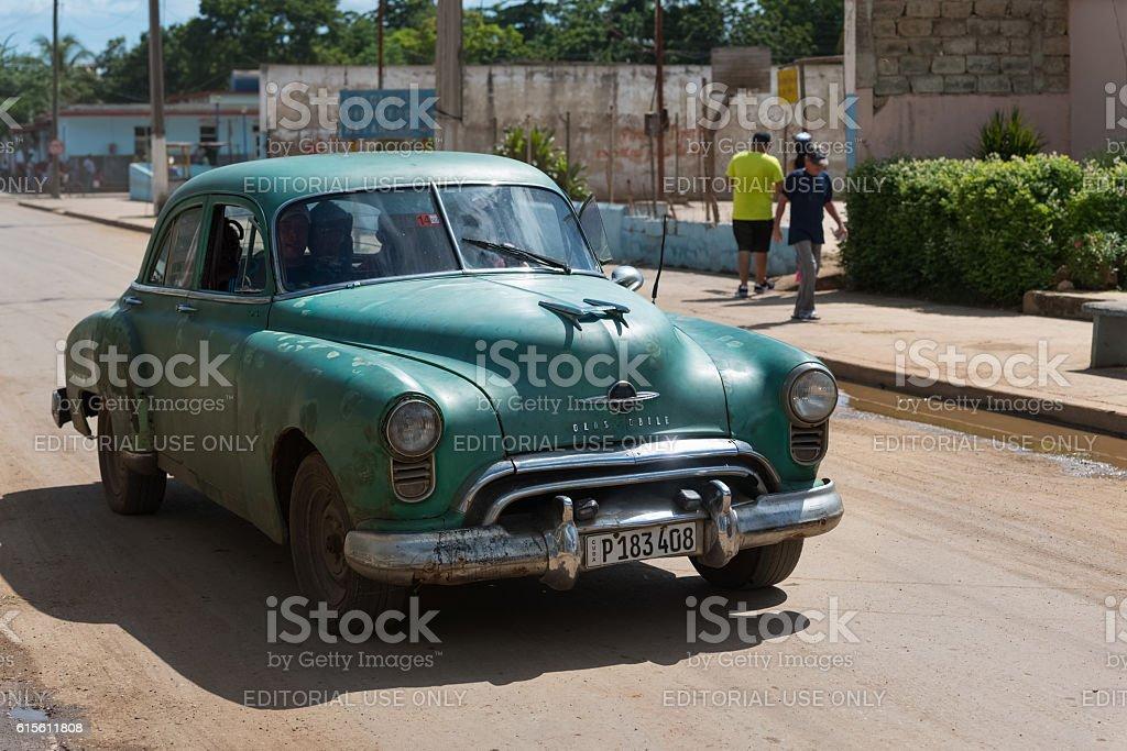 Green american Buick car drive on the street in Cuba stock photo