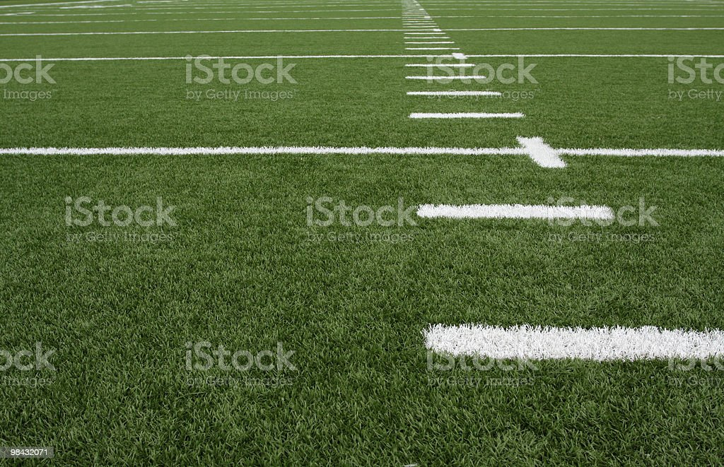 Green American football field with chalk lines stock photo