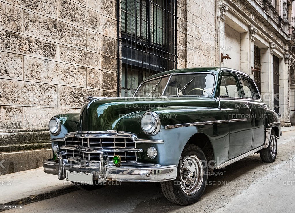 Green american vintage car parked in Havana Cuba stock photo