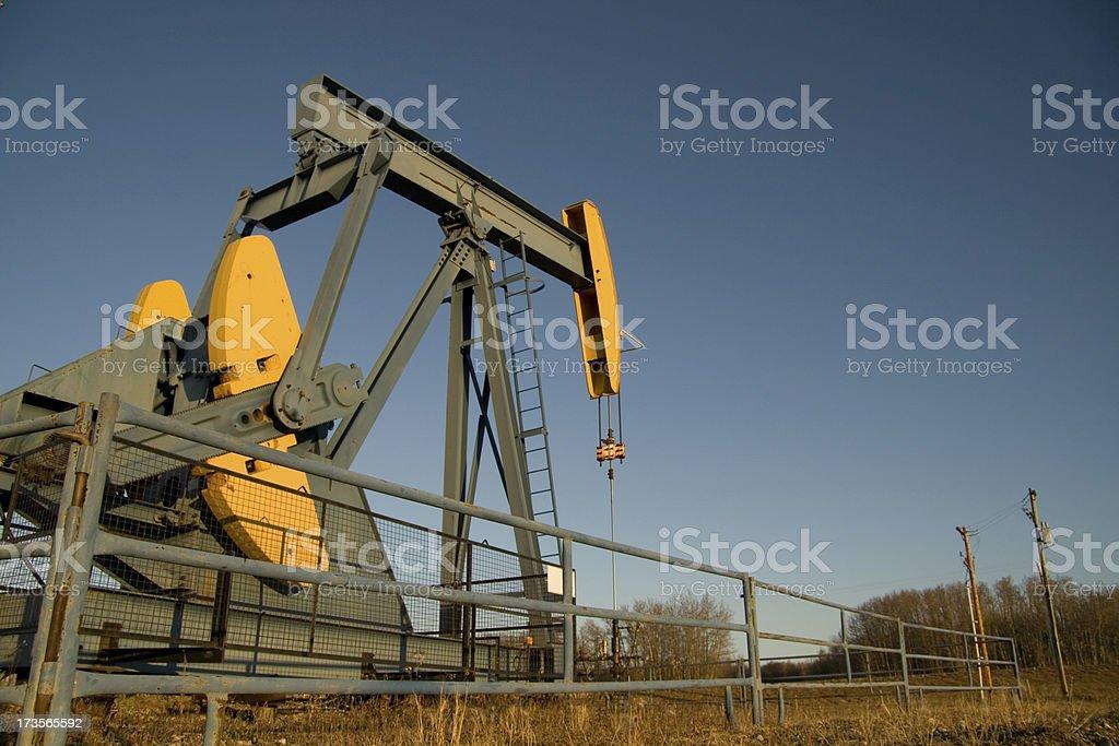 Green & Yellow pumpjack royalty-free stock photo