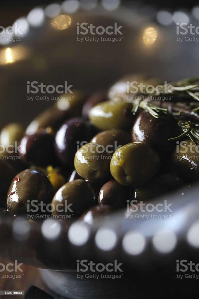 Green and Black Olives in Silver Bowl stock photo
