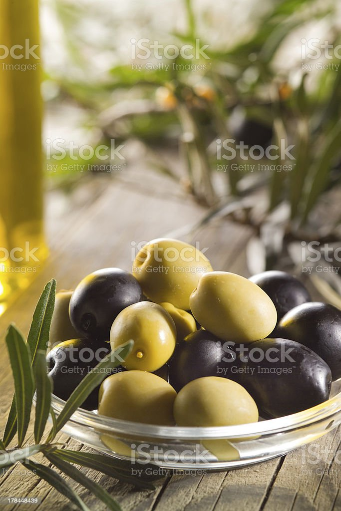 Green and black olives with leaves royalty-free stock photo