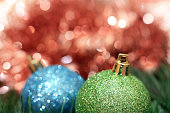 Green and blue christmas decoration ball with red bokeh