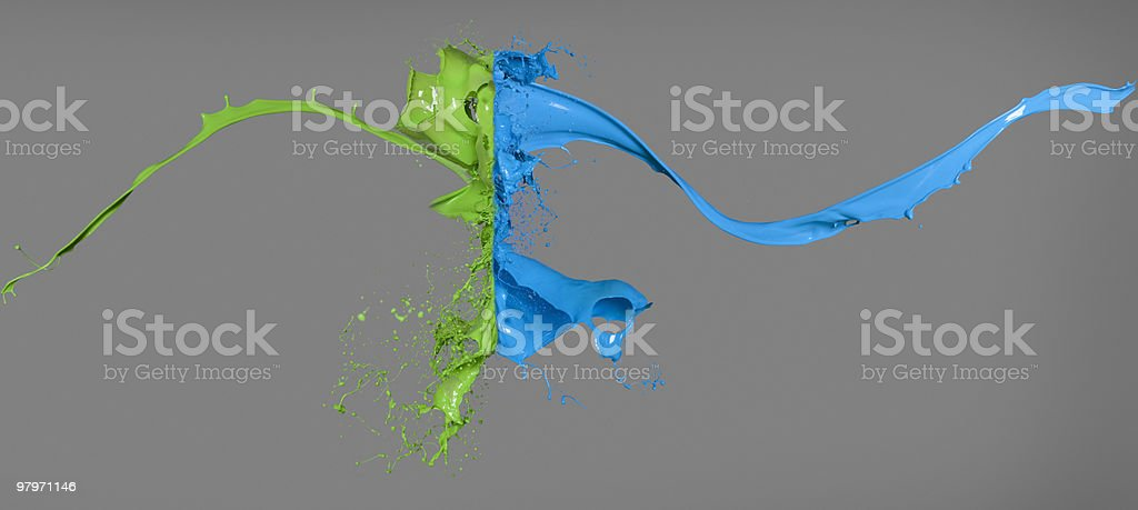 Green and blue paint colliding stock photo