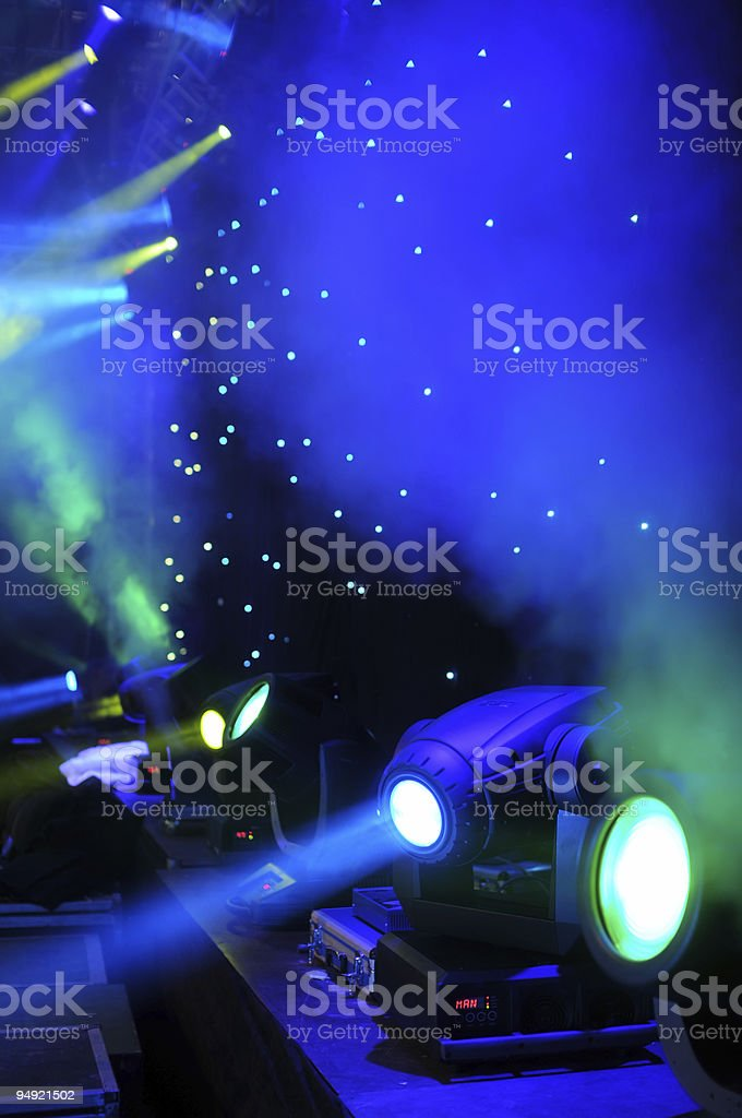 Green and blue stage lights projecting light royalty-free stock photo