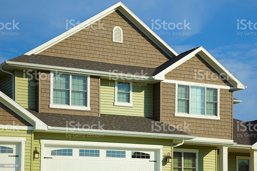Green and Brown House With Cedar, Vinyl Siding stock photo
