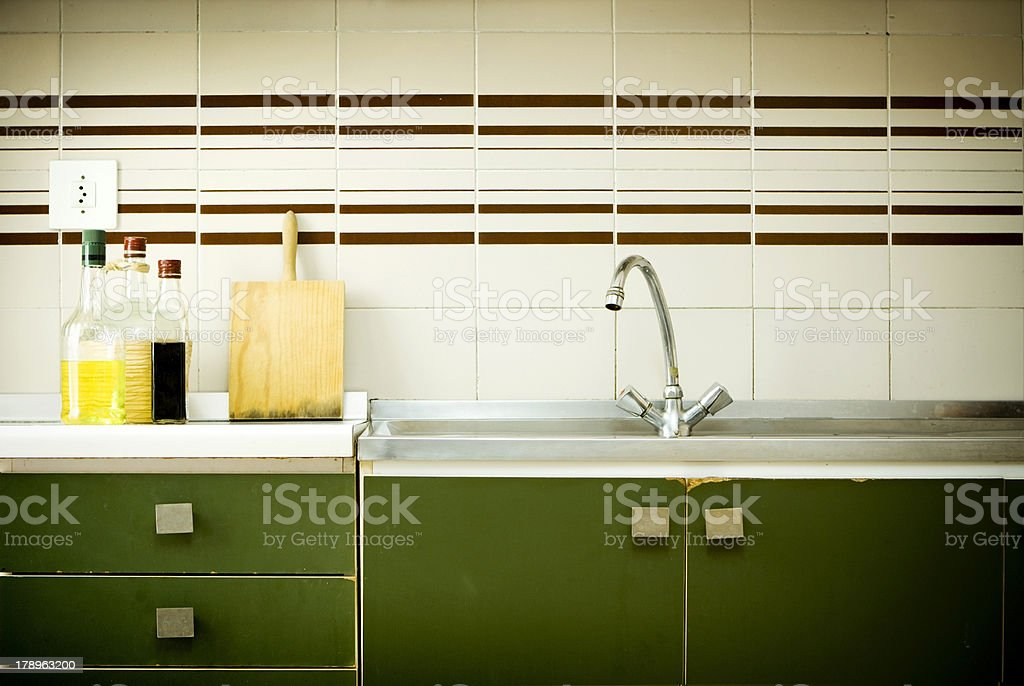 A green and brown striped retro style kitchen stock photo