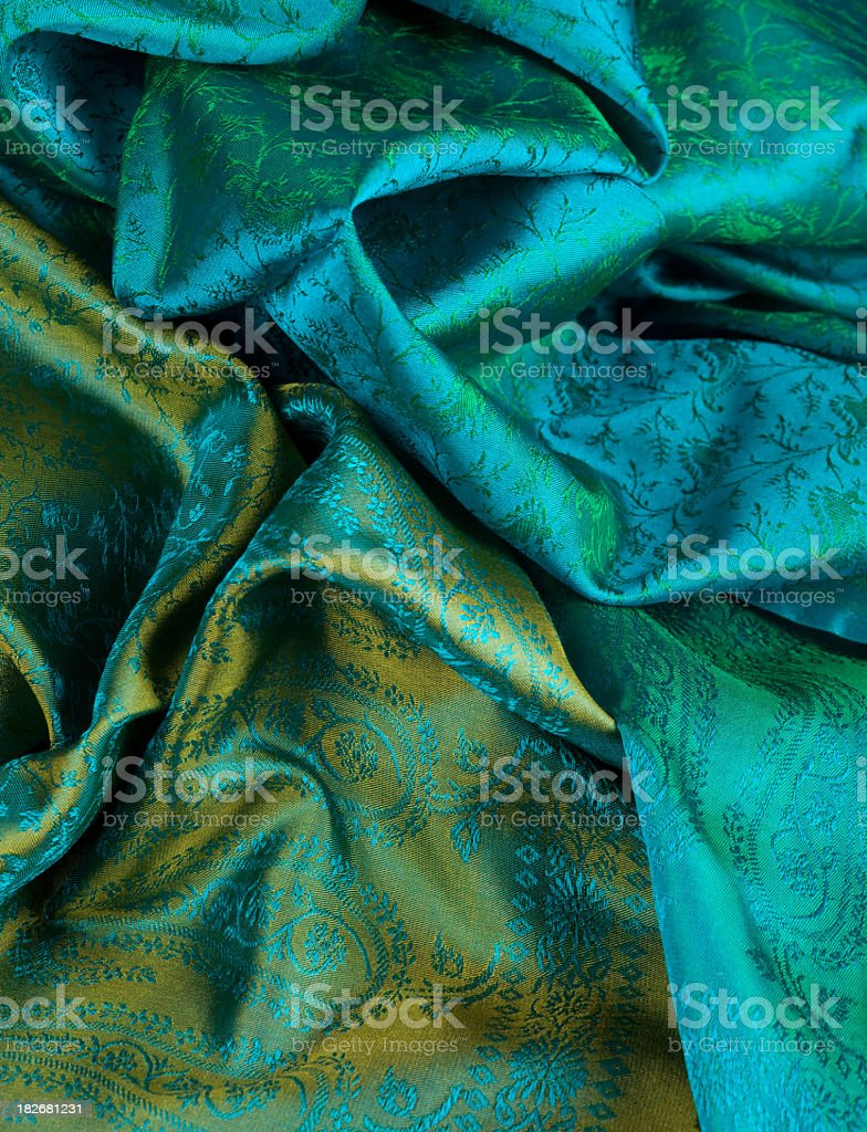 Green and gold fabric in Indian print royalty-free stock photo