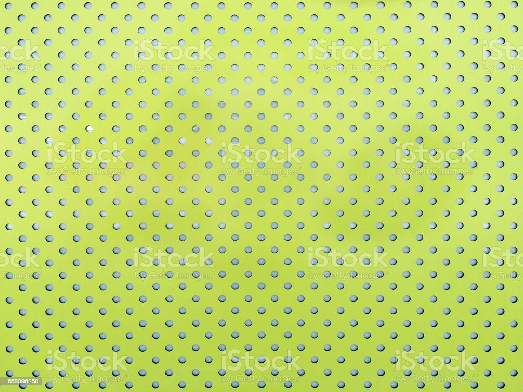Green and perforated metal sheet stock photo