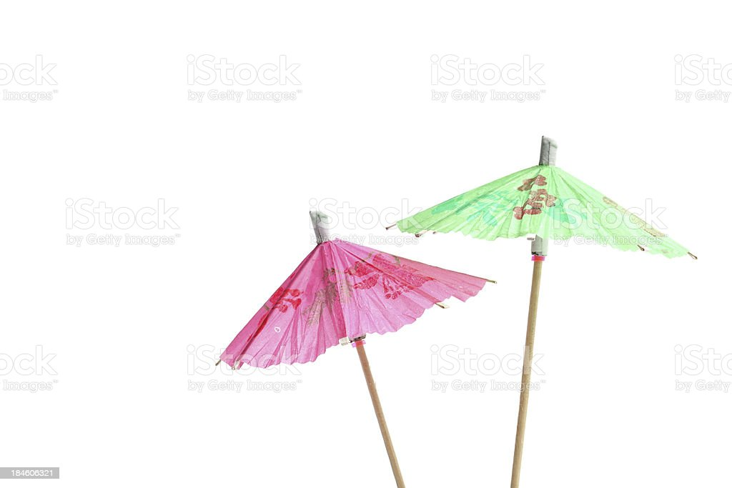 Green and pink open cocktail umbrellas royalty-free stock photo