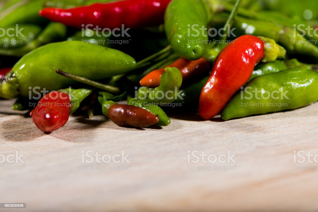 Green and red chillies in close up stock photo