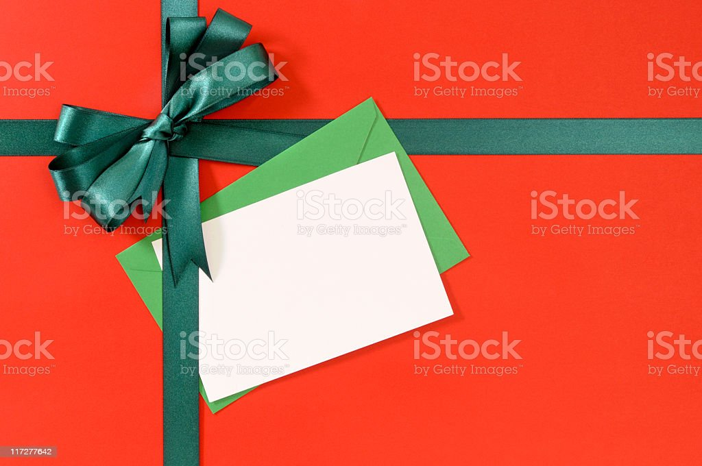 Green and red gift with blank message card royalty-free stock photo
