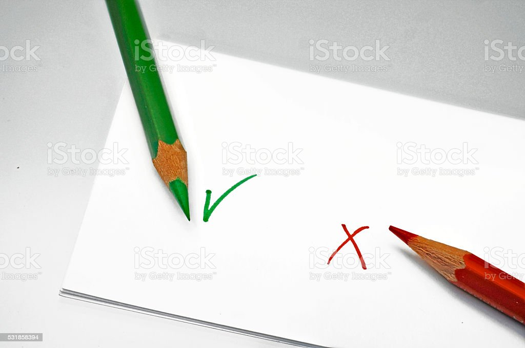 green and red pen hook and cross stock photo
