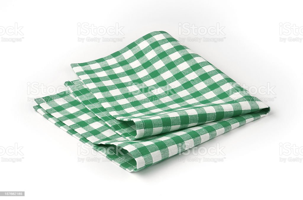 Green and white checked napkin roughly folded stock photo