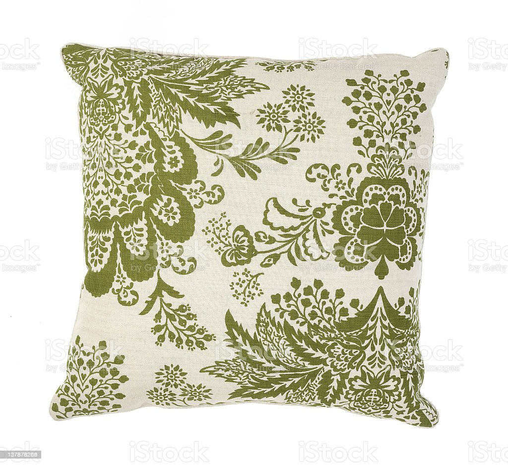 Green and white couch pillow with a floral pattern stock photo