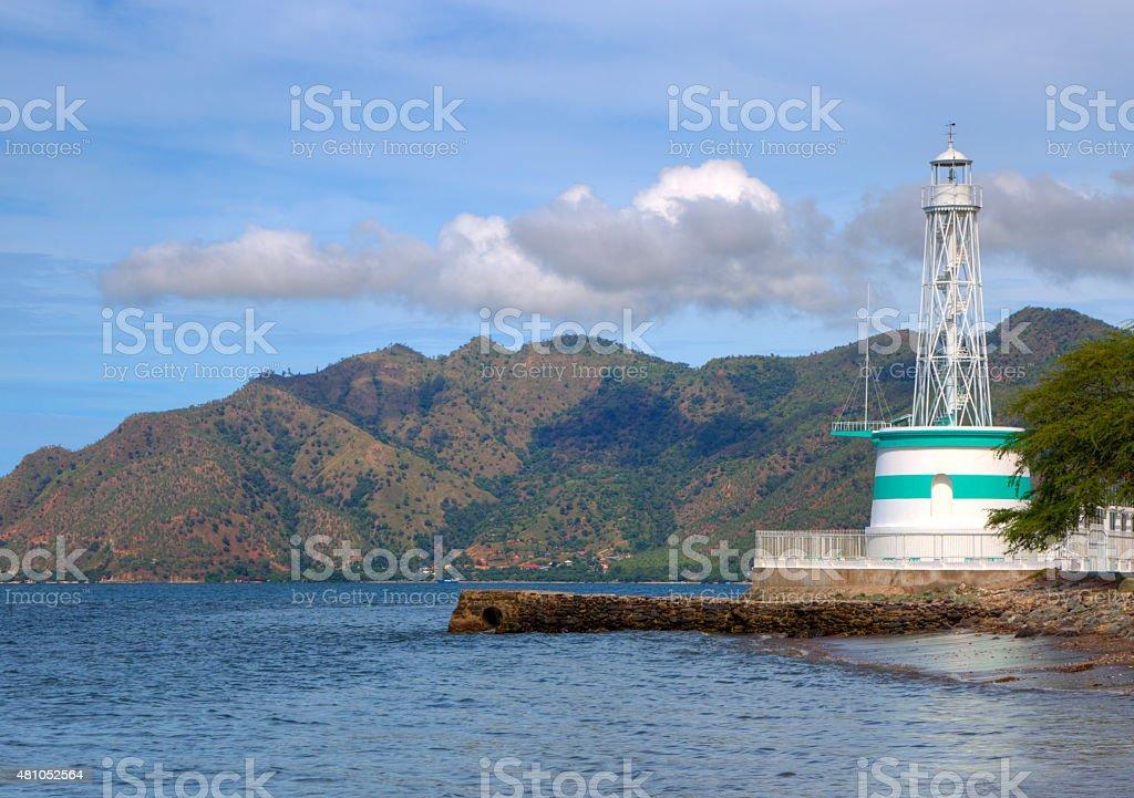 Green and white lighthouse in Timor Leste stock photo