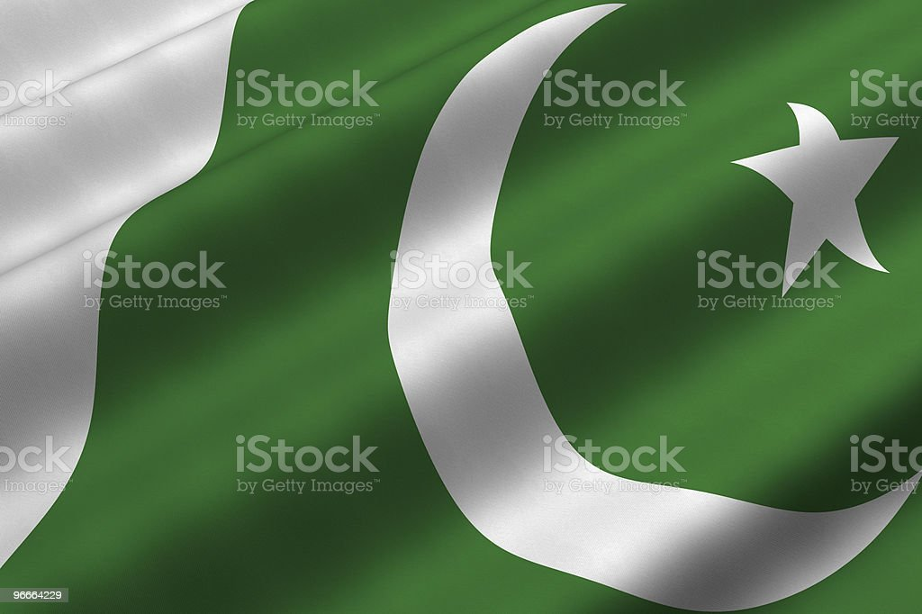 Green and white Pakistani flag with white moon and star stock photo
