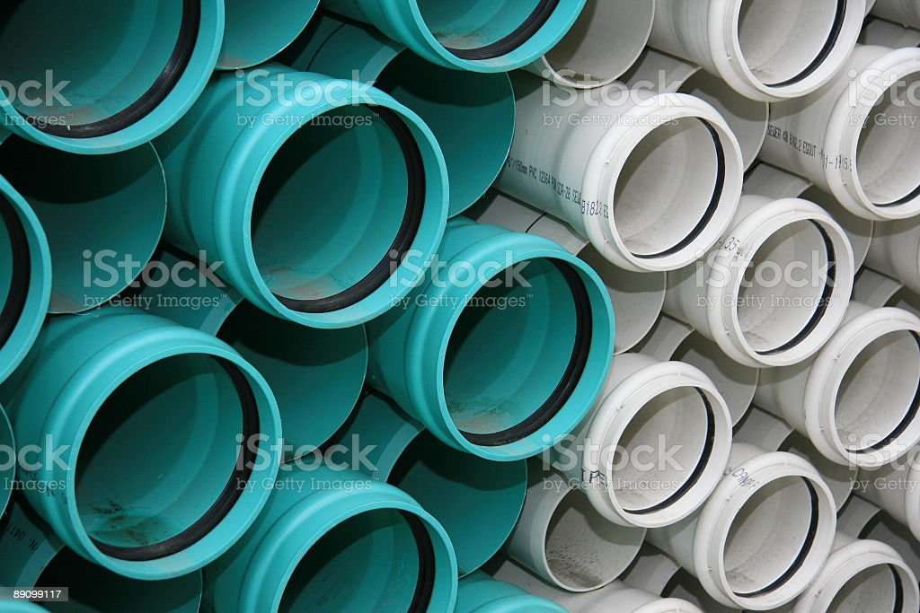 Green and White PVC Sewer Pipe royalty-free stock photo