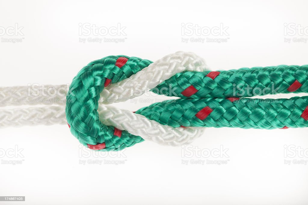 Green and white rope with a knot royalty-free stock photo