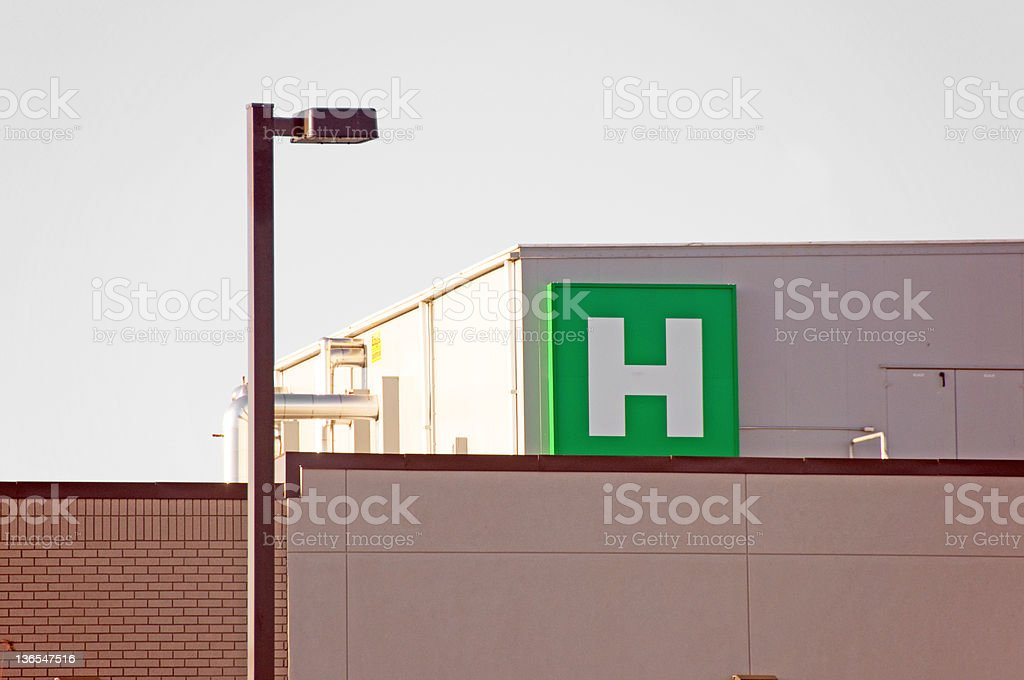 Green and white square shaped hospital sign on hospital royalty-free stock photo