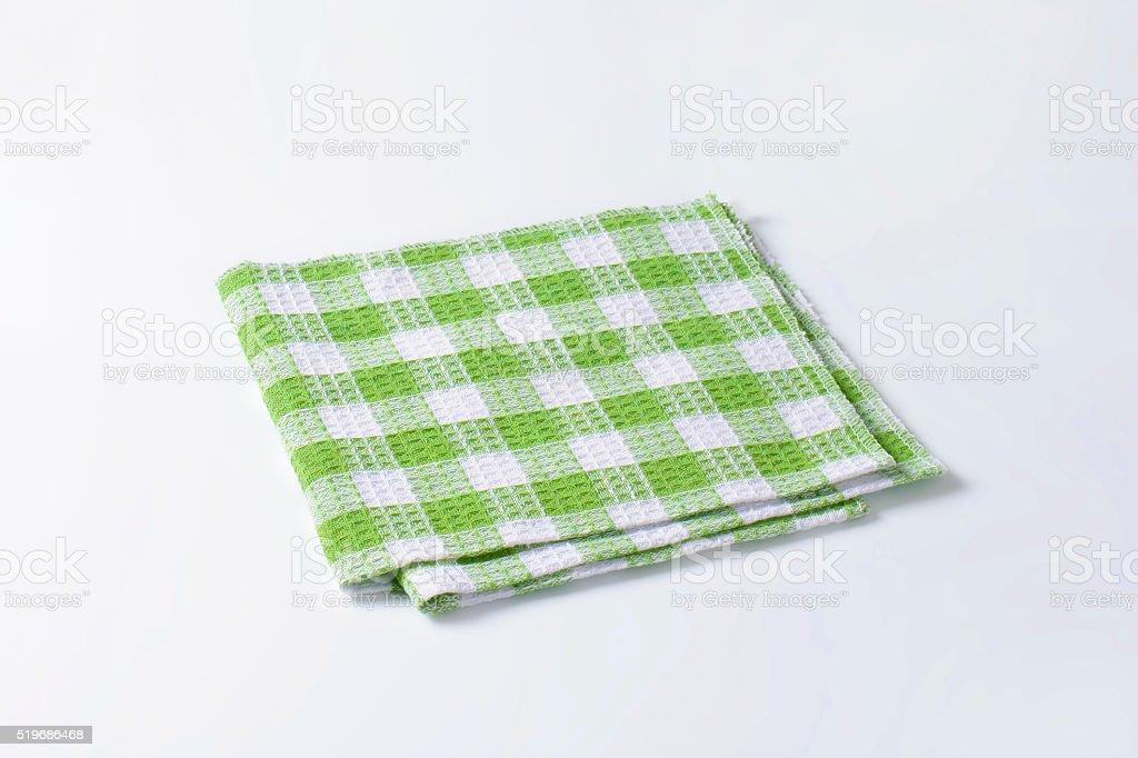 Green and white tea towel stock photo